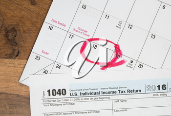 Calendar on top of form 1040 income tax form for 2016 showing tax day for filing is April 18 2017