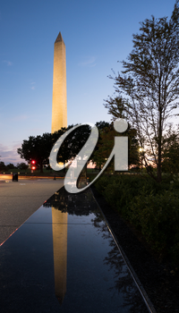 Reflection of Washington Monument at sunset in the polished top of a marble bench