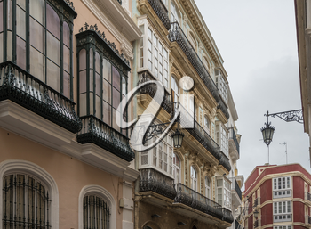 Cast iron balconies on Calla Ancha shopping street in city of Cadiz in Southern Spain