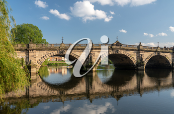 View of river Severn and English Bridge in Shrewsbury Shropshire with retirement apartments in background