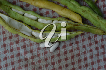 Beans. Phaseolus. Bean Seeds. Legumes. Kitchen. Recipes. Tablecloth. Before cooking. Delicious. It is useful. Close-up. Horizontal