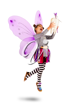 A very joyful Tooth Fairy with bouncing and flying wings holds an extracted tooth