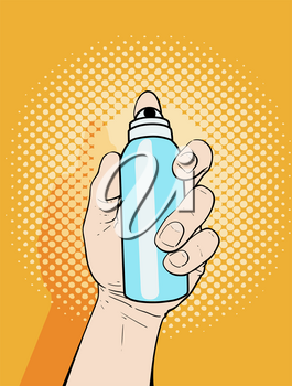 Male hand holding an aerosol can of paint or deodorant spray