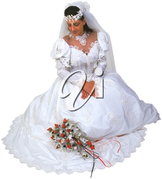 Royalty Free Photo of a Bride Kneeling Down
