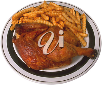 Royalty Free Photo of a Plate of Chicken and French Fries