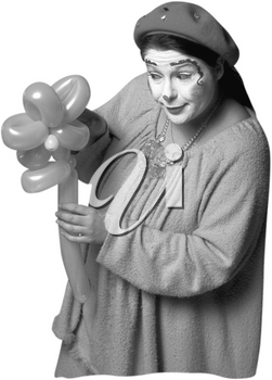 Royalty Free Photo of a Clown Holding Balloons