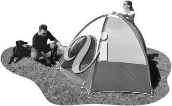 Royalty Free Photo of a Couple Pitching a Tent While the Dog Watches