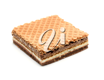 Wafer with hazelnut and milk cream on white background.