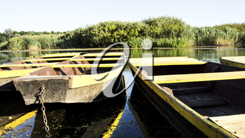 Row boat floating on the lake and reflects out of water