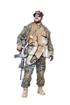Studio shot of United States Marine with rifle weapons in uniforms. Military equipment, army helmet, combat boots, tactical gloves. Isolated on white, weapons, army, patriotism concept