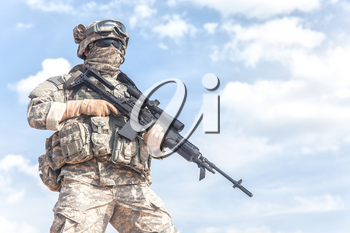 Portrait of United states airborne infantry marksman with arms, camo uniforms dress. Combat helmet on, face mask, cropped