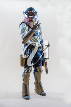 Lviv, Ukraine - May 23.2015:Cosplayer boy posing in a steampunk suit and a resprator mask , Photo taken at cosplayers meeting indoor concert hall in Lviv city.May 23.2015