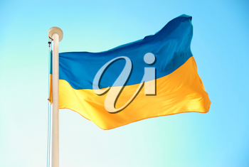 Ukrainian blue and yellow flag on the sky background