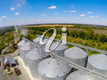 Flight of the grain terminal from the drone. The grain plant for storage and drying of grain. Grain terminal. Plant for the drying and storage Rice plant in the middle of fields.