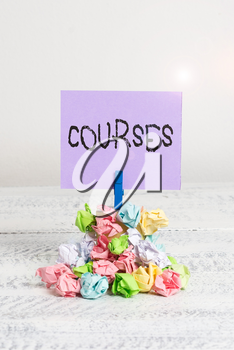 Word writing text Courses. Business photo showcasing Route Direction followed Classes Land Water Area for sports Reminder pile colored crumpled paper clothespin reminder white wooden space