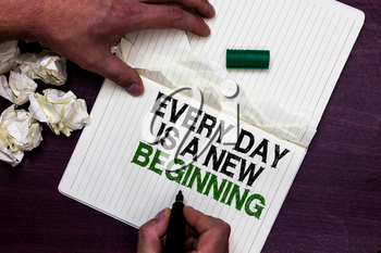 Text sign showing Every Day Is A New Beginning. Conceptual photo you have a chance to dream work live better Man holding marker notebook page crumpled papers several tries mistakes