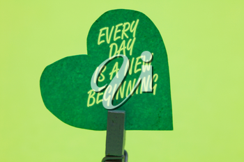 Conceptual hand writing showing Every Day Is A New Beginning. Business photo showcasing you have a chance to dream work live better Clothespin holding green paper heart romantic message ideas