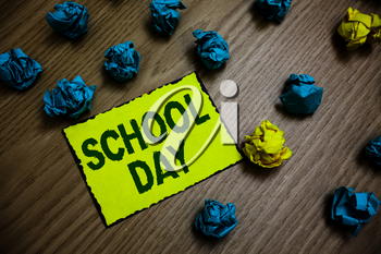 Word writing text School Day. Business concept for starts from seven or eight am to three pm get taught there Yellow piece paper reminder lots crumpled papers several tries wooden floor