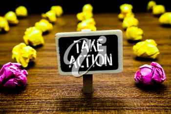 Text sign showing Take Action. Conceptual photo advices someone to do something or reaction right now Blackboard crumpled papers several tries mistake not satisfied wooden floor