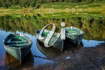 Rowing Boats Moored at Watendlath Tarn in the Lake District Cumbria