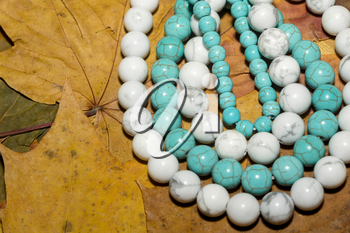 Beads with natural stone blue and white turquoise close up.
