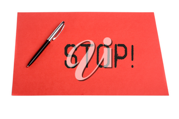 Stop word and pen and plain color paper on  isolated background