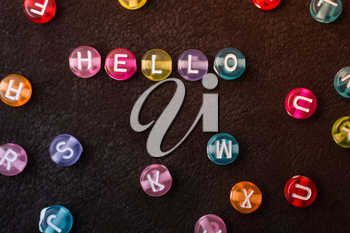 Hello wording formed with Multi color alphabet letter beads
