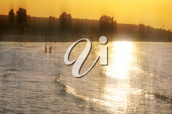 Children playing at the beach. Sunset light leaking on sea water vintage style photo composite.