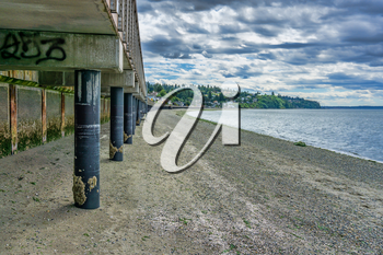 A view from beneath the boardwalk at Redondo Beach, Washington. The tide is low.