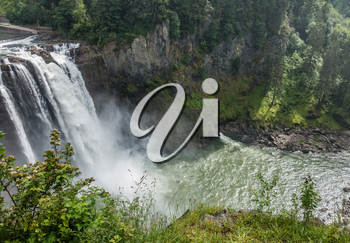 Water explodes into a waterfall in Snoqualmie, Washington.