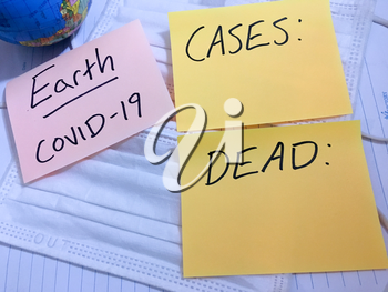Coronavirus COVID-19 Earth infection medical cases and deaths. China COVID respiratory disease influenza virus statistics hand written on surgical mask and earth globe background