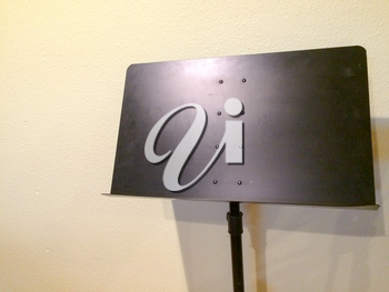 Sheet Music stand black color metal against white wall