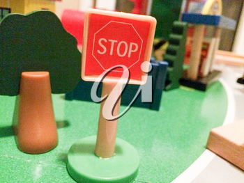 Red stop sign in toy city play town in miniature size