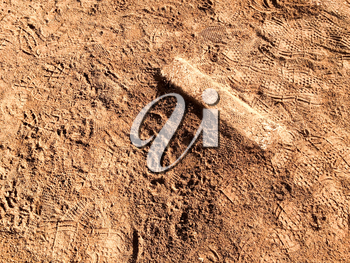 Baseball Pitchers mound with rubber step in brown dirt
