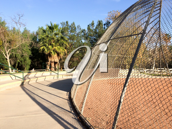 Baseball field backstop outdoor at park no people on sunny day