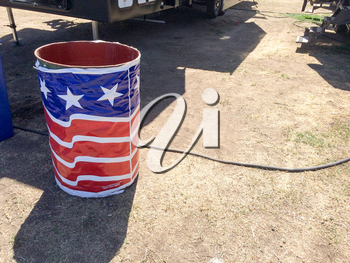 Trash can wrapped in american flag banner concept for recycle problem