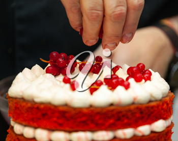 Red velvet cake preparation. It is composed of buttermilk or vinegar component that activated with the baking soda to make it super fluffy or velvety.