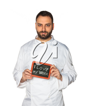 Young chef in white uniform with chalkboard isolated on white background.