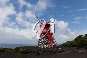 Typical mill made from black volcanic rock and red blades