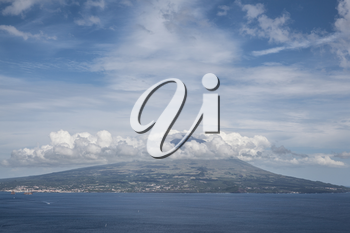 Mountain of PIco with clouds forming around its peak, a view from Faial, Azores, Portugal